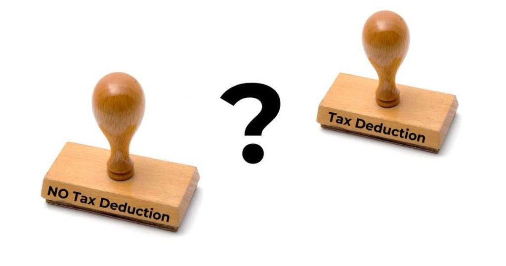 """rubber stamps saying """"Tax Deductions"""" and """"No Tax Deductions"""""""