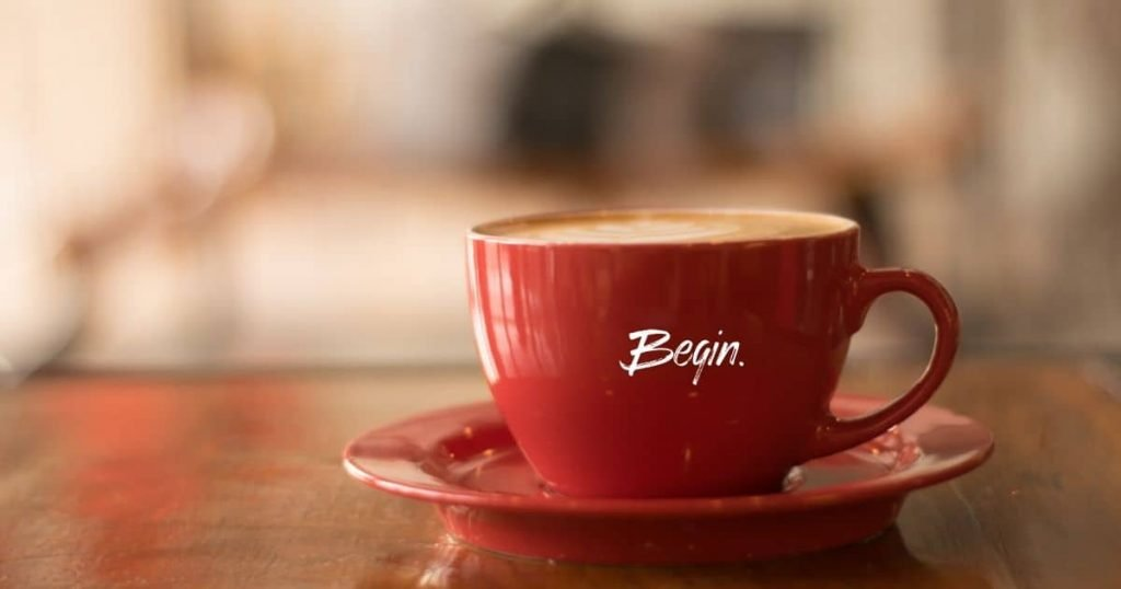 cup of coffee with begin on it - begin for money anxiety